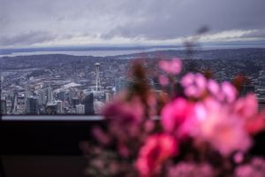 Seattle in the background of the wedding flowers.