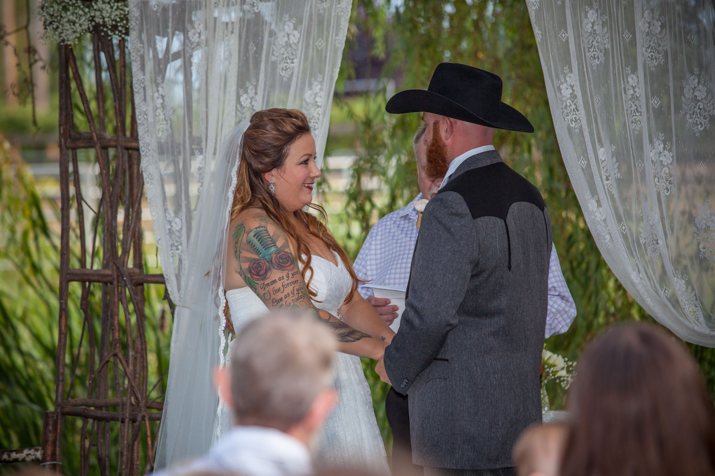 Bride and groom saying wedding vows.