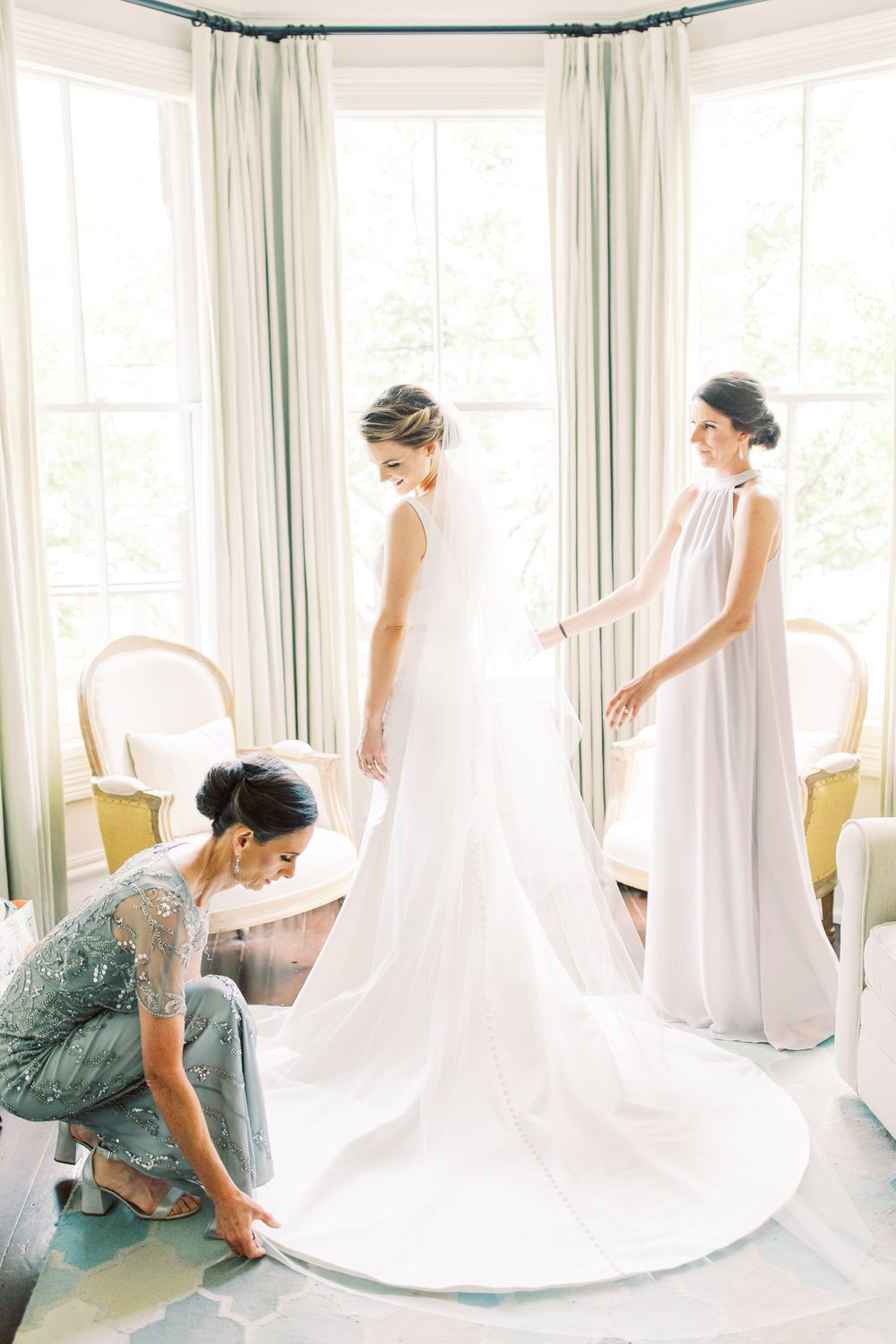 bride gets ready with the help of her mother and maid of honor at the mirabelle suites in downtown savannah, ga