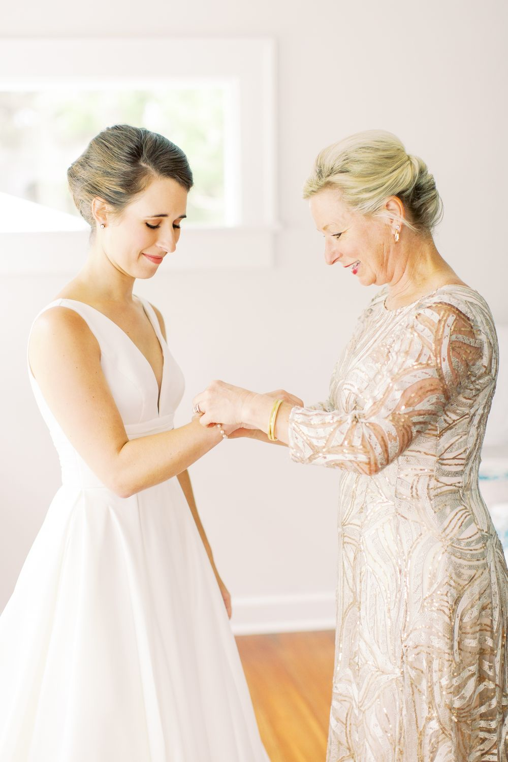 bride and mother share a moment while getting ready for wedding day in wilmington island home