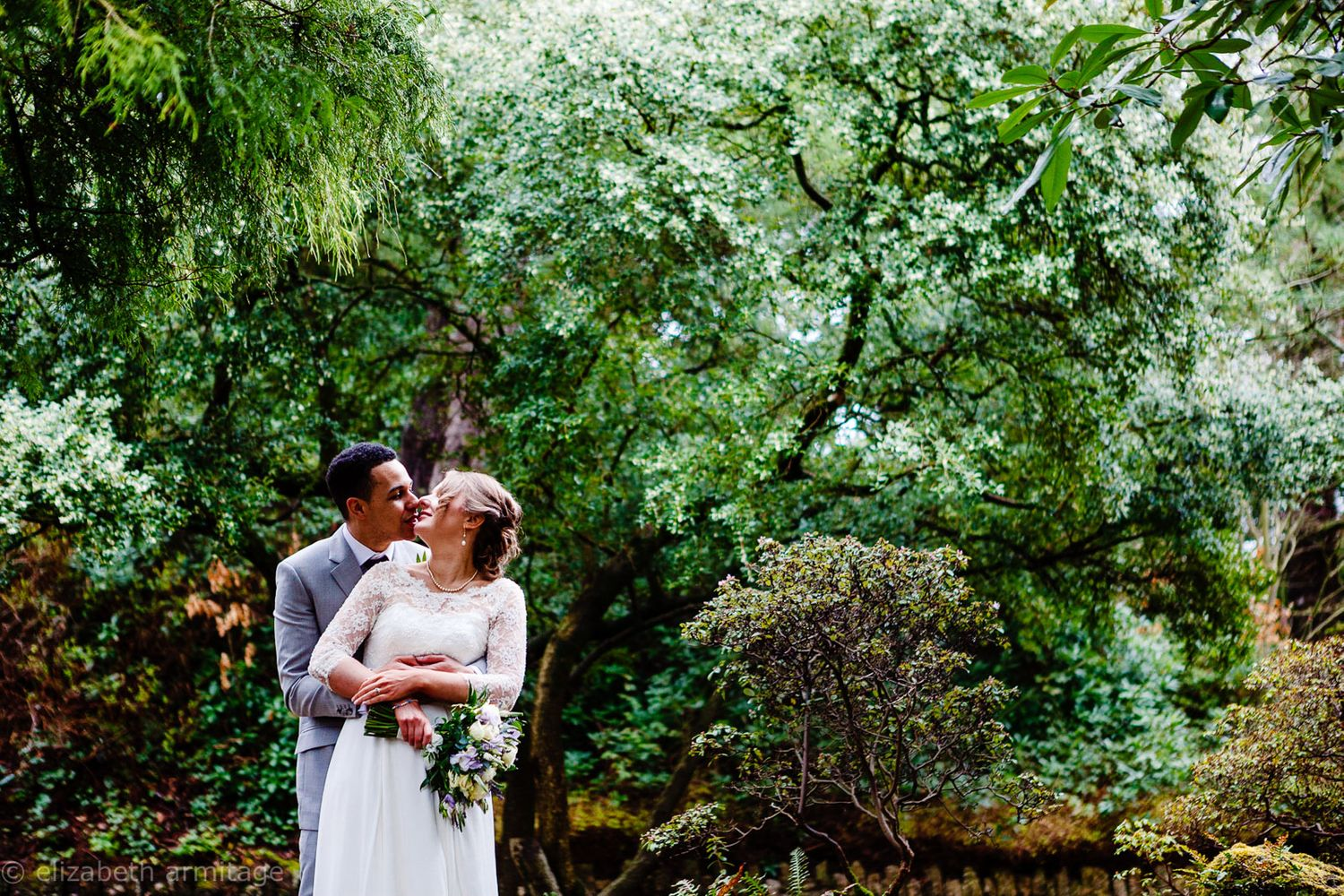 bride and groom embrace at Reed Hall Exeter wedding