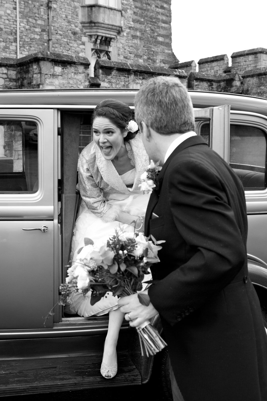 bride arriving at Powderham Castle Devon for wedding reception