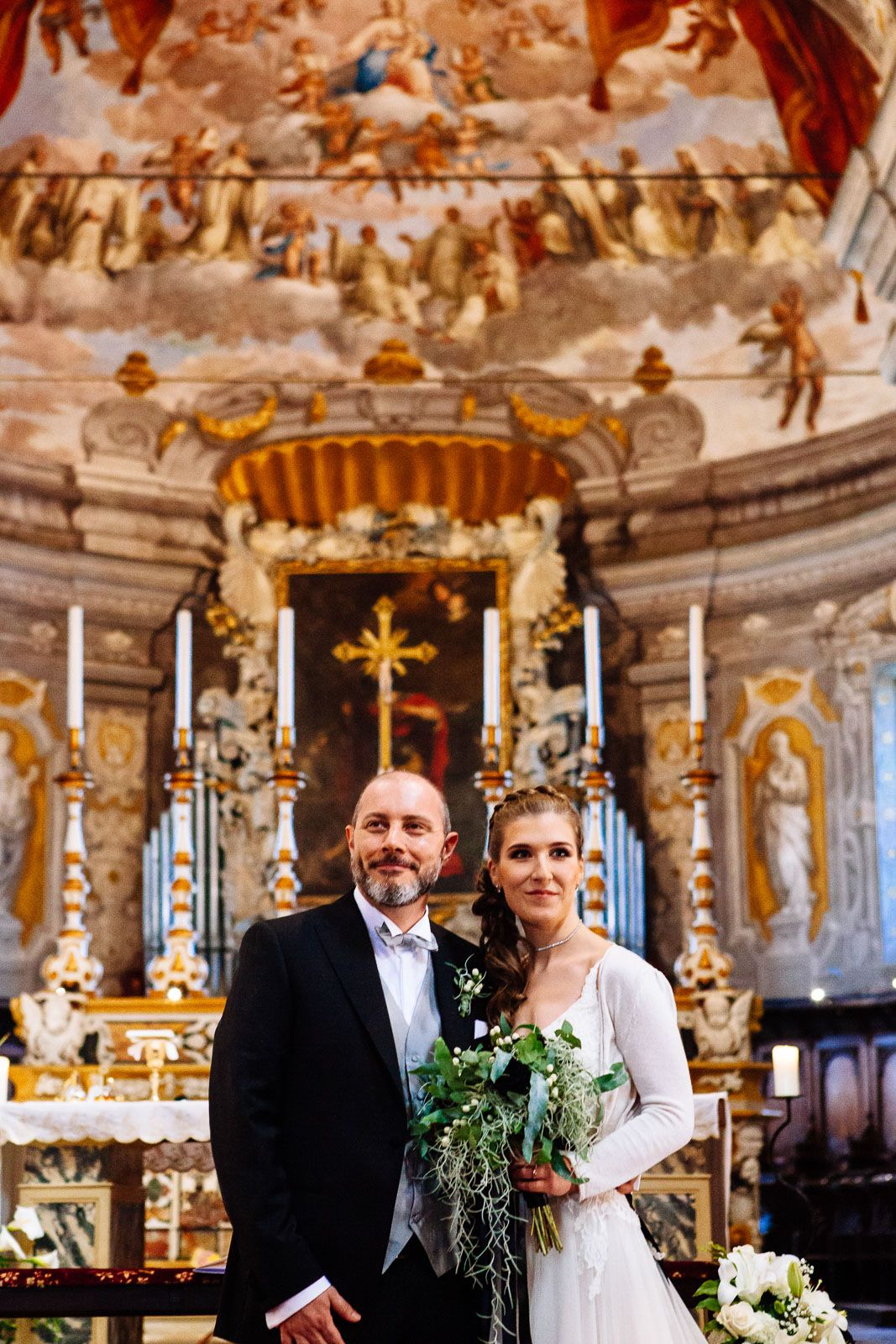 wedding couple in church in Ferrara Italy by destination wedding photographer