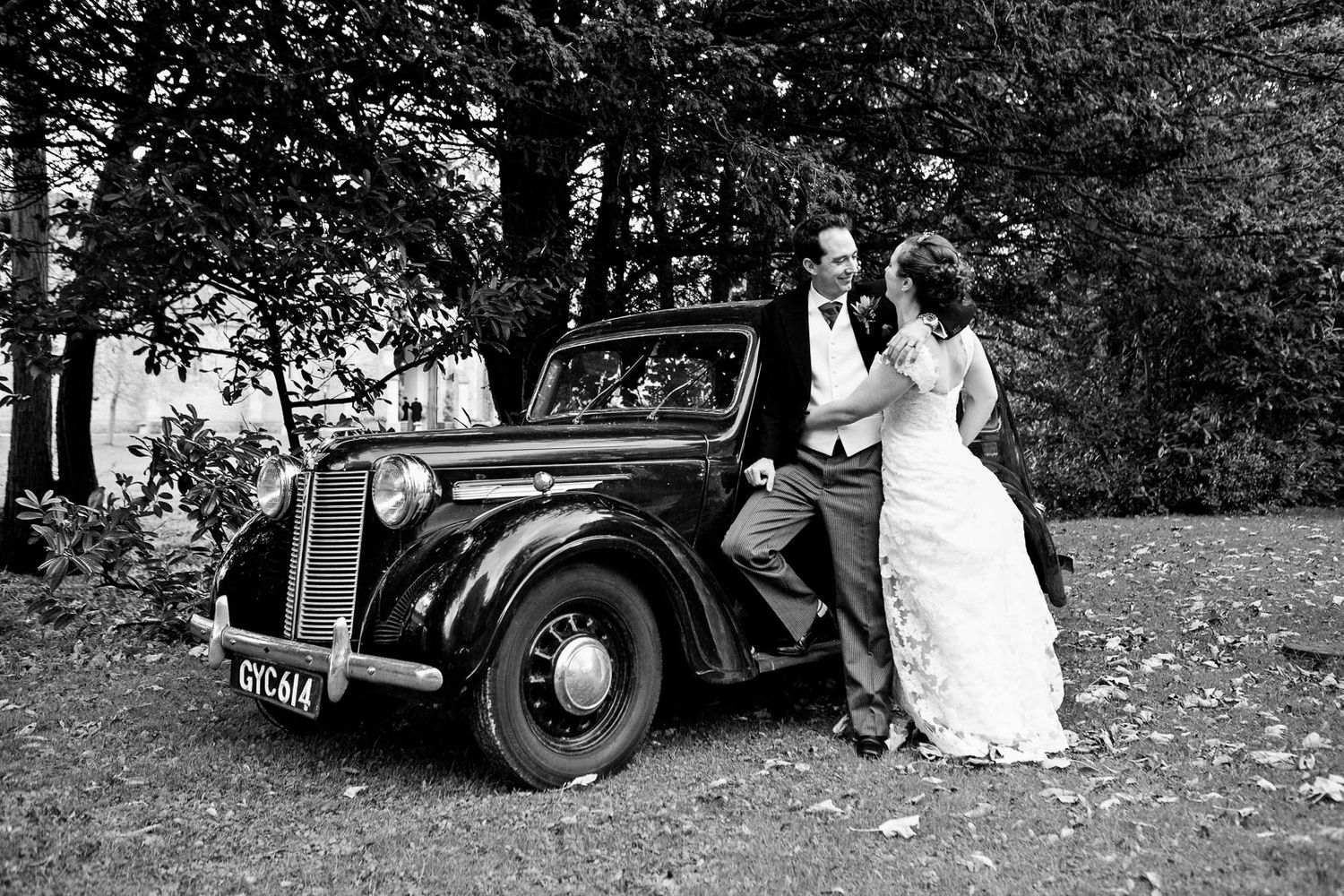 photograph of bride and groom with classic car