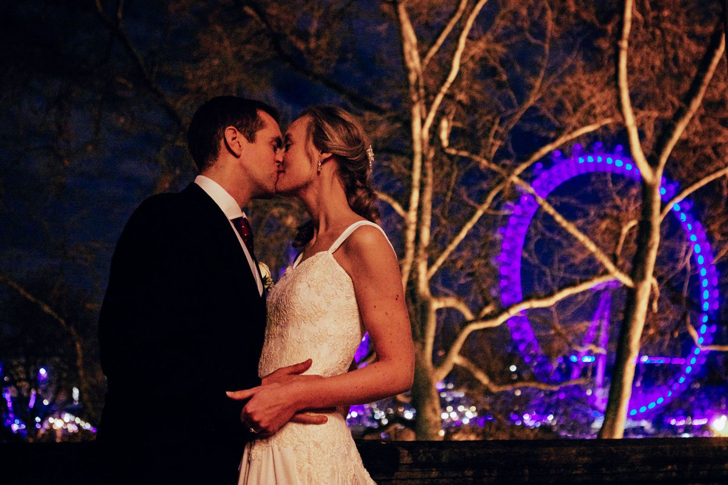 wedding photograph of bride and groom with London Eye in the background by destination wedding photographer