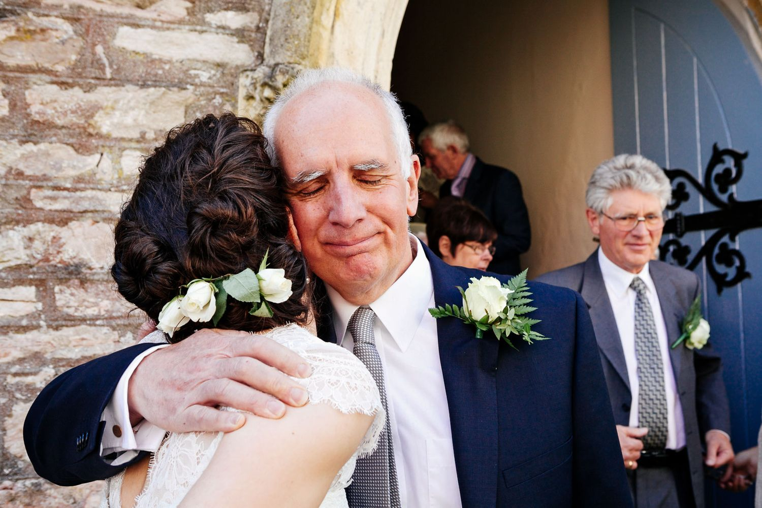 photograph of father-of-the-bride and bride having a beautiful moment after the wedding ceremony