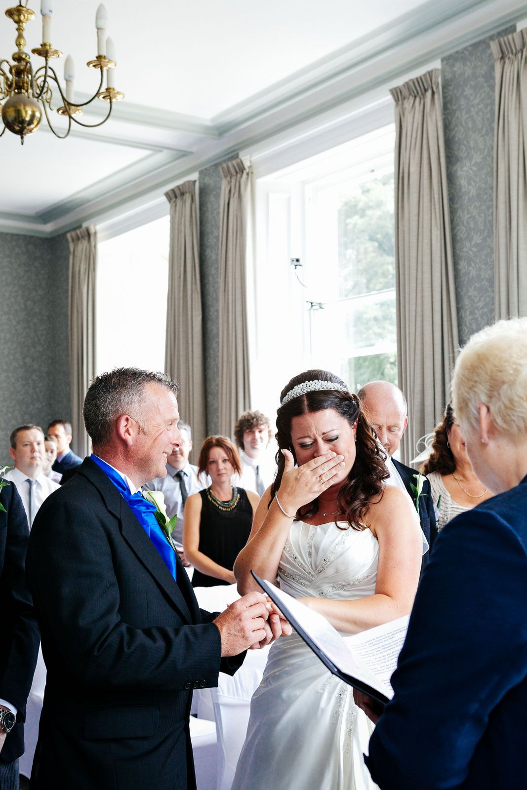 photography of a touching moment at Reed Hall Exeter Devon wedding