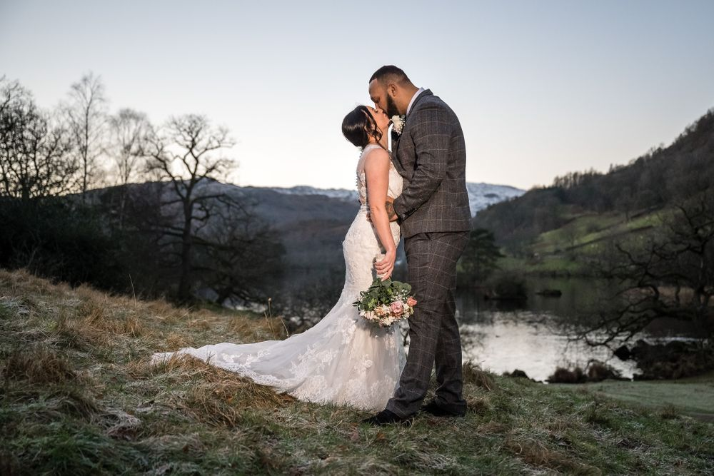 Bride and groom at dusk by Rydal Water