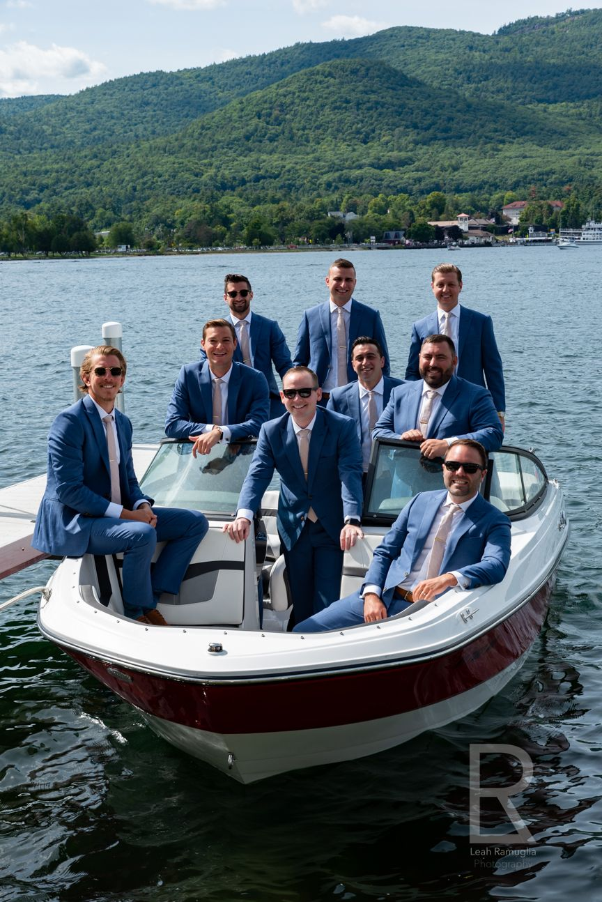Leah Ramuglia Photography groomsmen on a boat in Lake Charles, NY, New York destination wedding