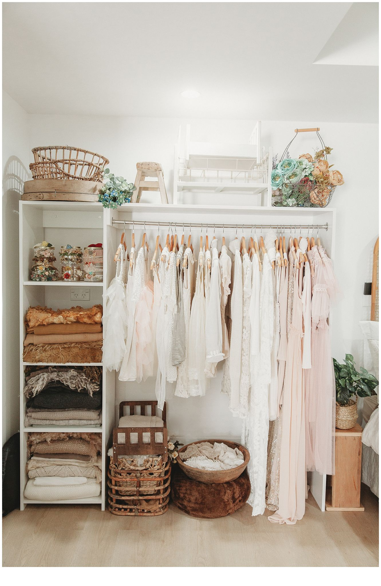 stacey lake photography studio wardrobe filled with beautiful earthy tones, rustic props and wooly layers