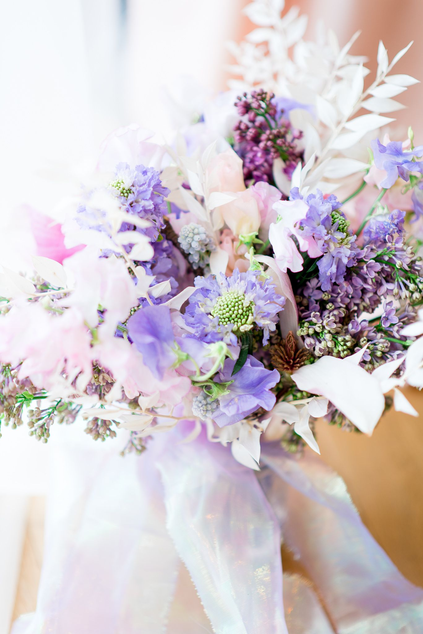 colorful wedding bouquet with purple lilacs and pink sweet pea flowers for a spring wedding bouquet