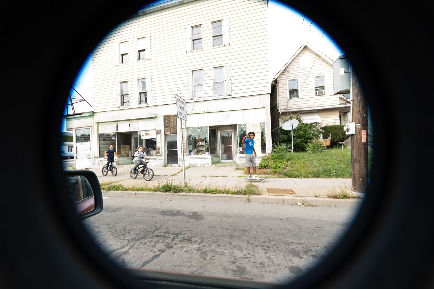 Street youths with lens cap @ 8mm. Binghamton, NY