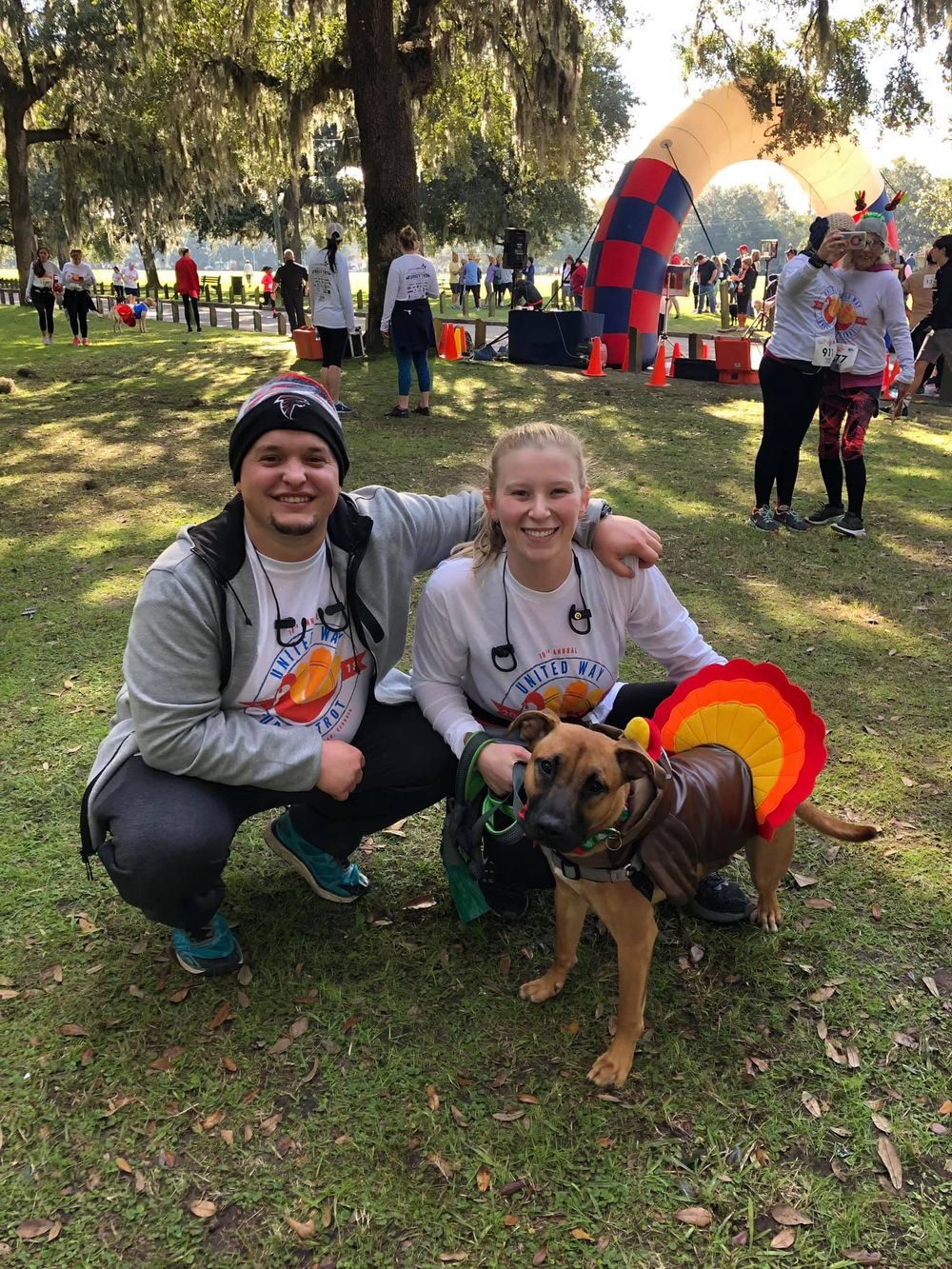 kayley and josh with their dog after a 5k in savannah