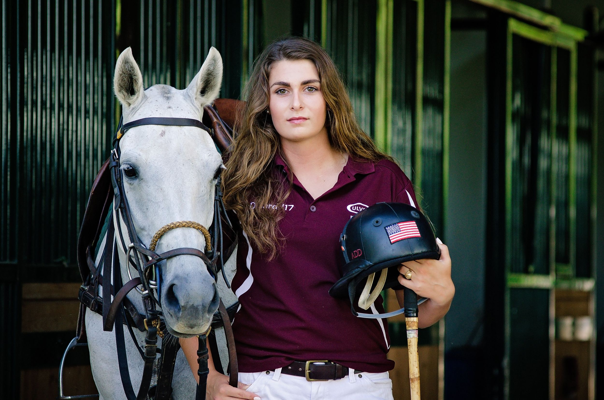Polo player and thoroughbred mare horse