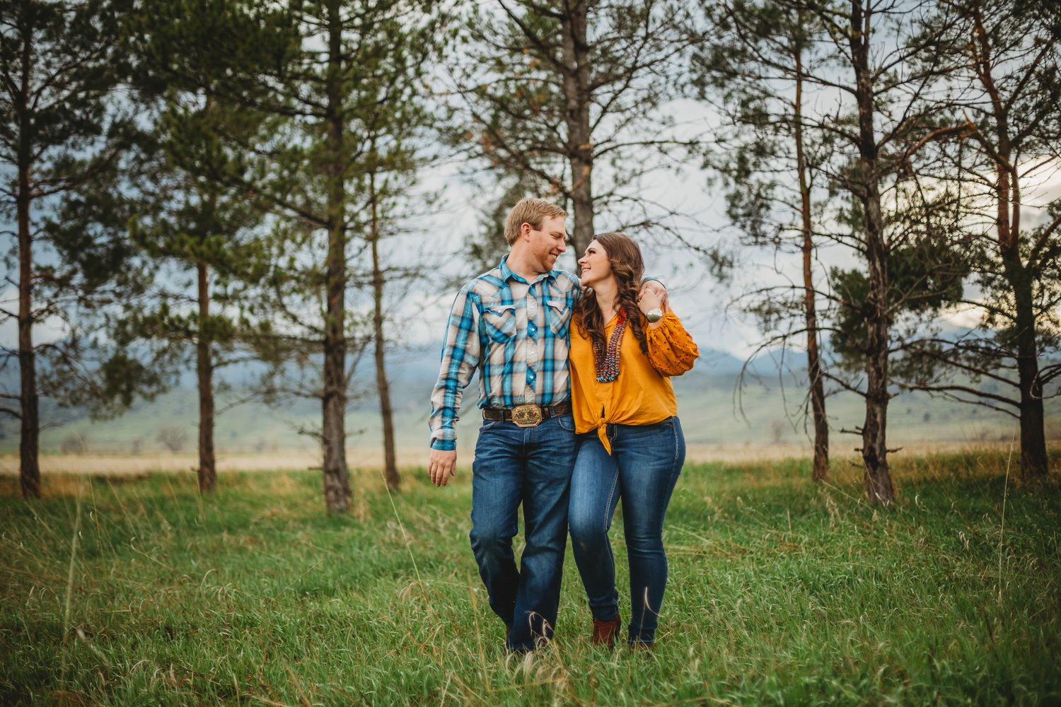 A couple gazes at eachother during their Colorado engagement session at Reservoir Ridge Natural Area in Fort Collins, CO