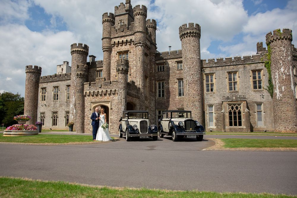 hensol castle vintage cars and bride and groom picture