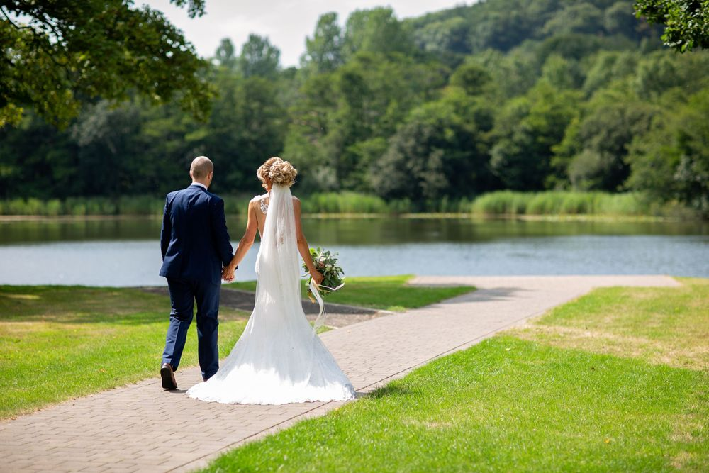 bride and groom walking to the lake at hensol castle