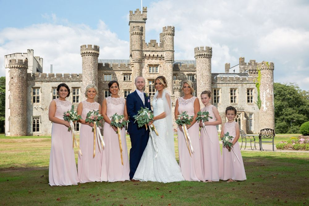 perfect formal wedding picture bride groom and bridesmaids in front of hensol castle
