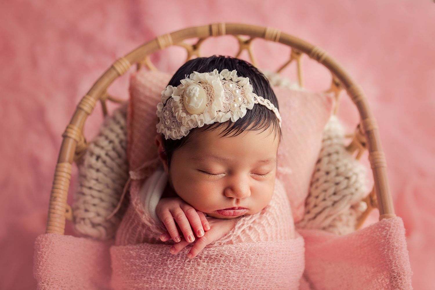 baby close up sleeping in basket pink clothing