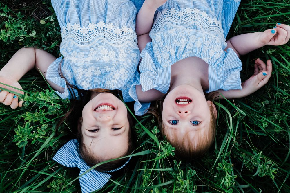 Two girls in blue dress on the grass