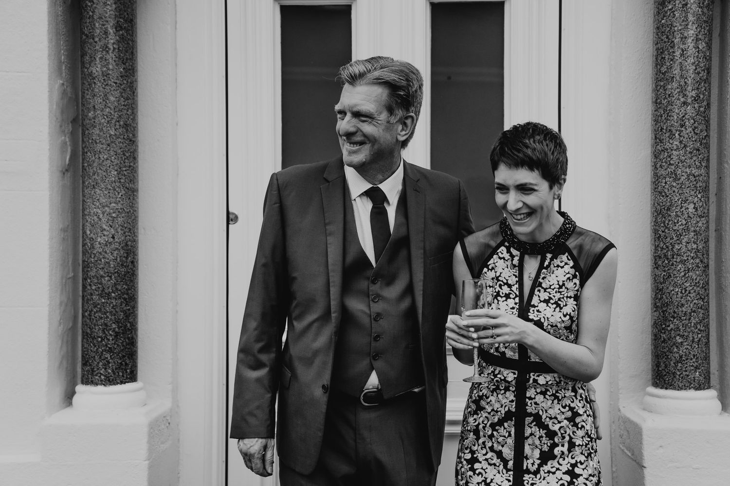 Black and white photo of the bride and her father at their Salisbury home on the wedding morning.