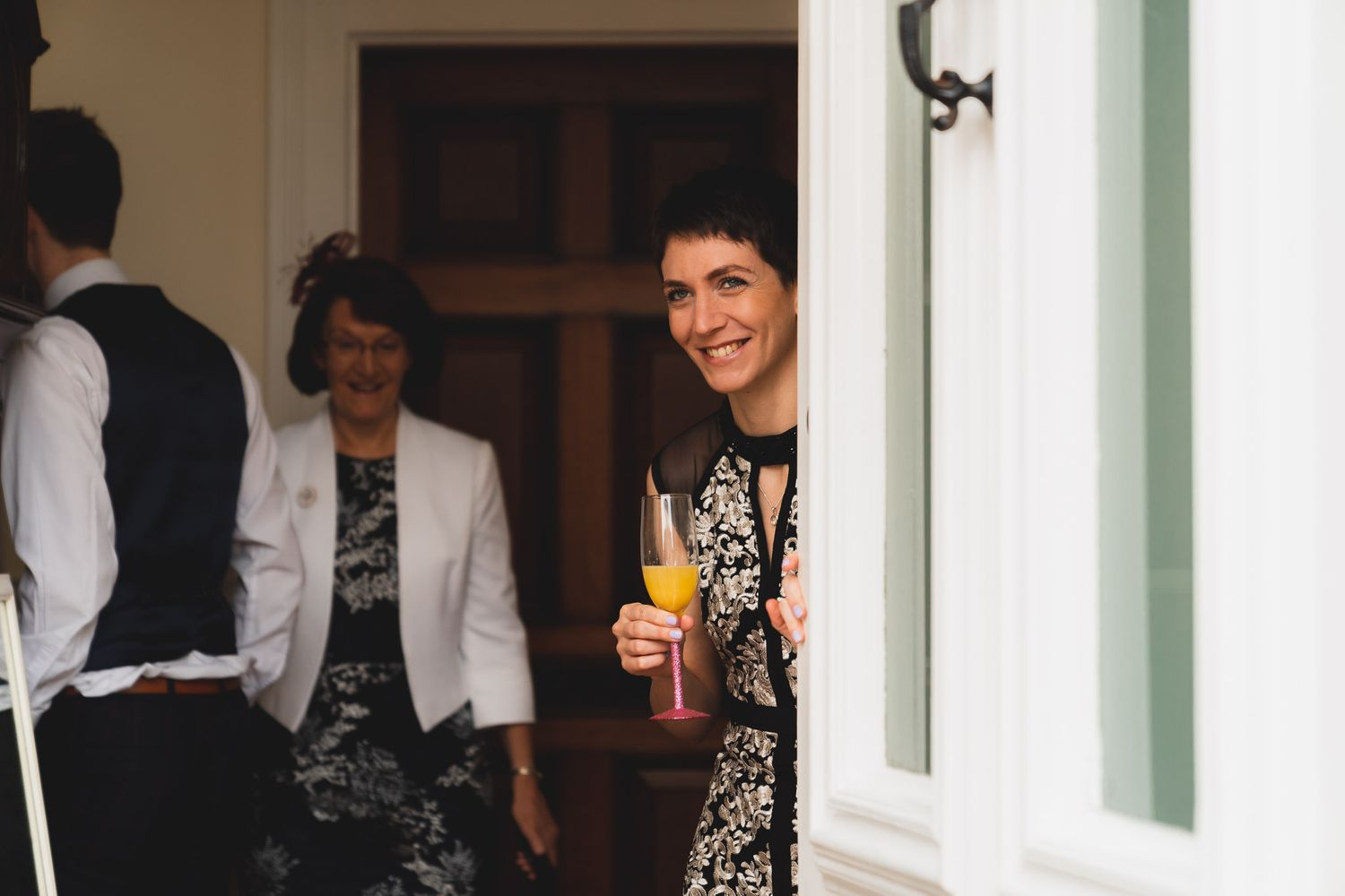 Bride opens the front door at her Salisbury home on the morning of her wedding.