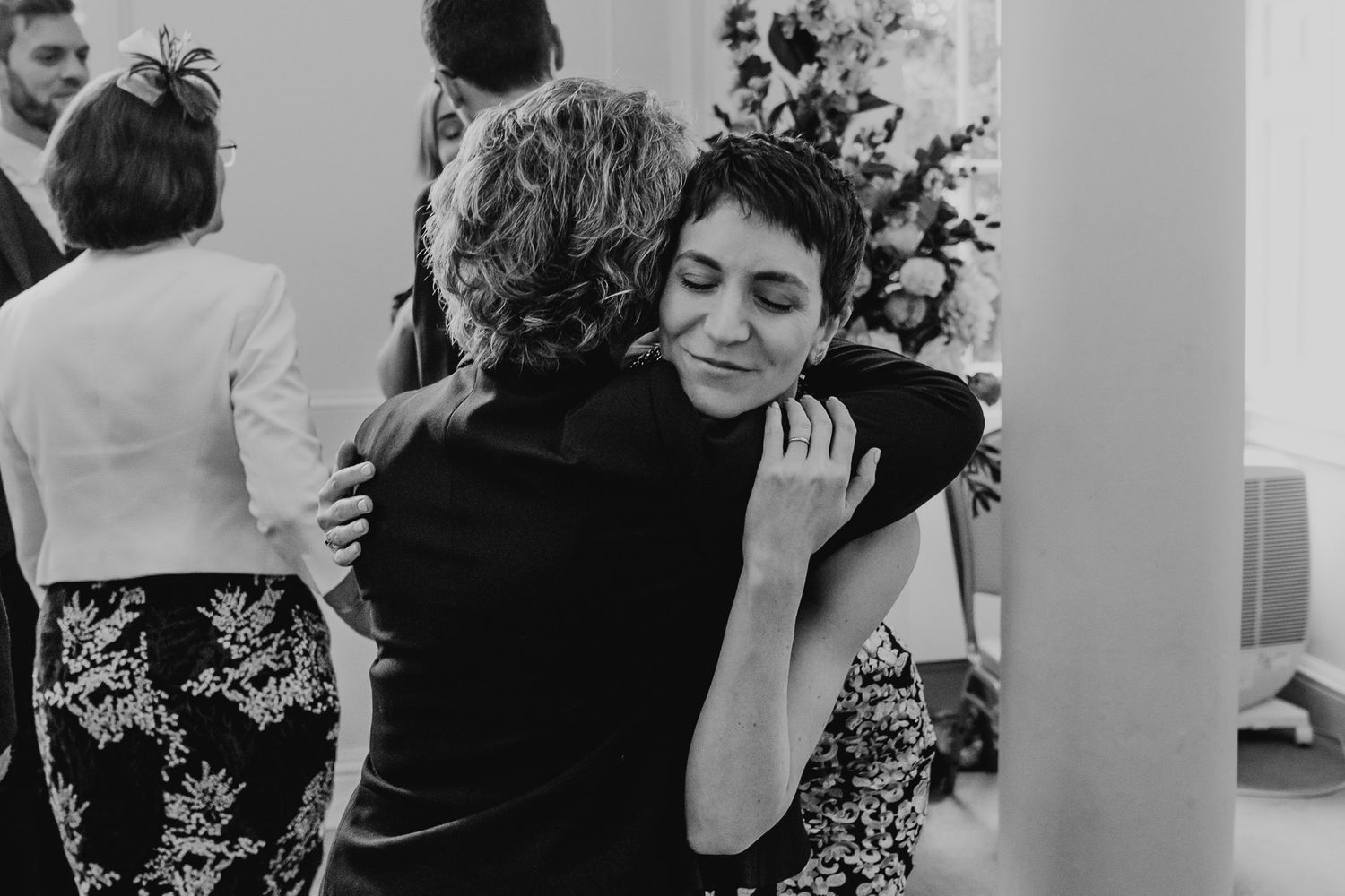 Black and white photo of bride hugging her aunt after the ceremony in Salisbury Registry Office.