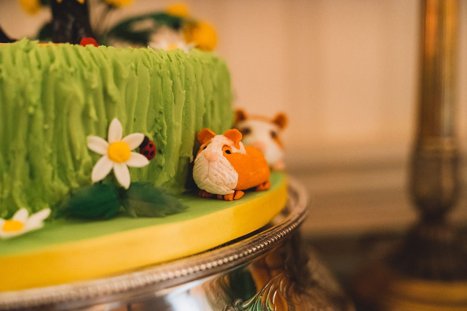 Icing ginger guinea pig on a wedding cake.