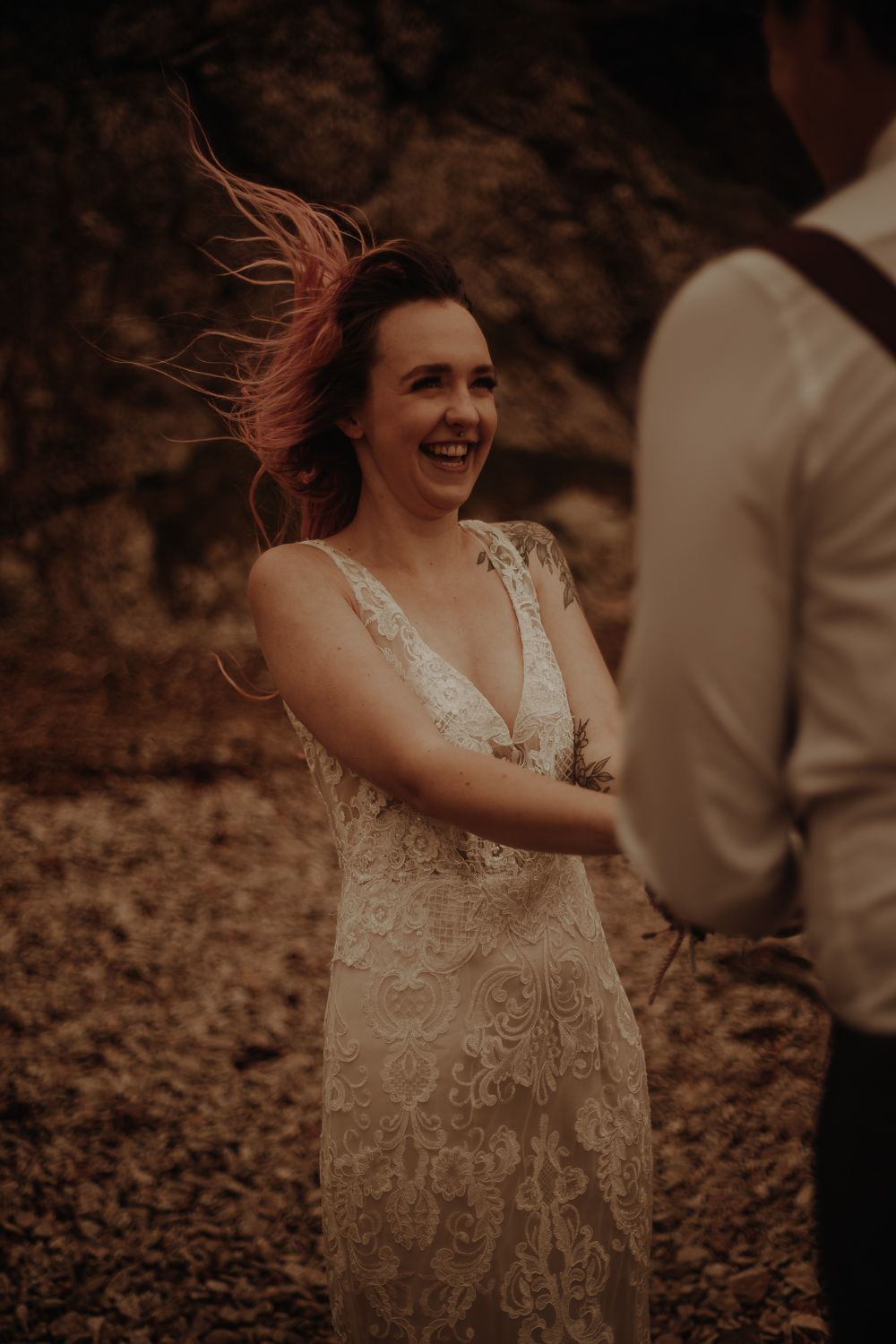 Bride with wind blowing in hair at elopement