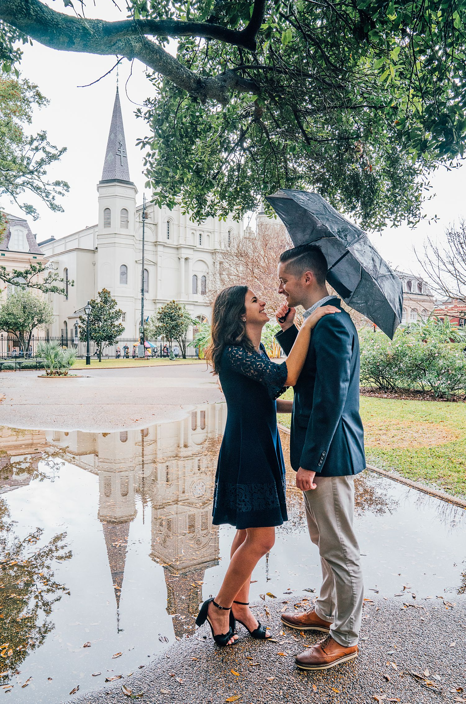 Engaged Couple in Lafayette Square on Rainy Day