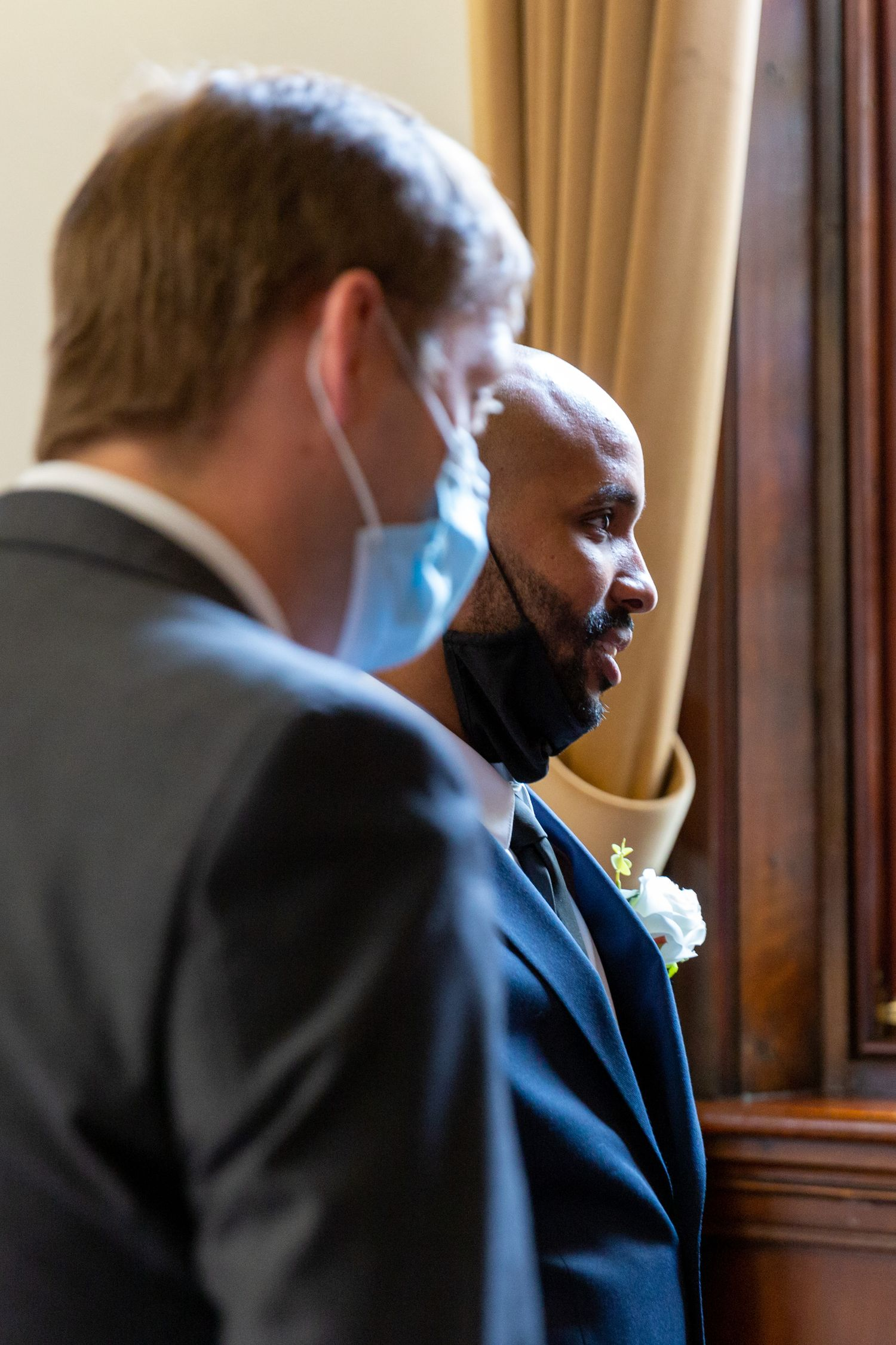 groom and best man chat to the registrar in st.helens town hall