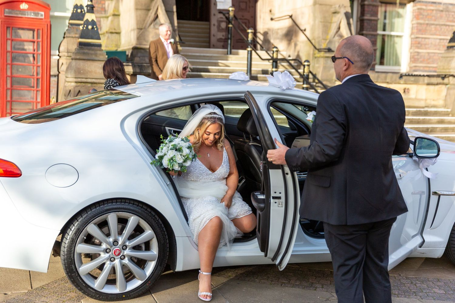 bride getting out of the wedding car outside st.helens town hall