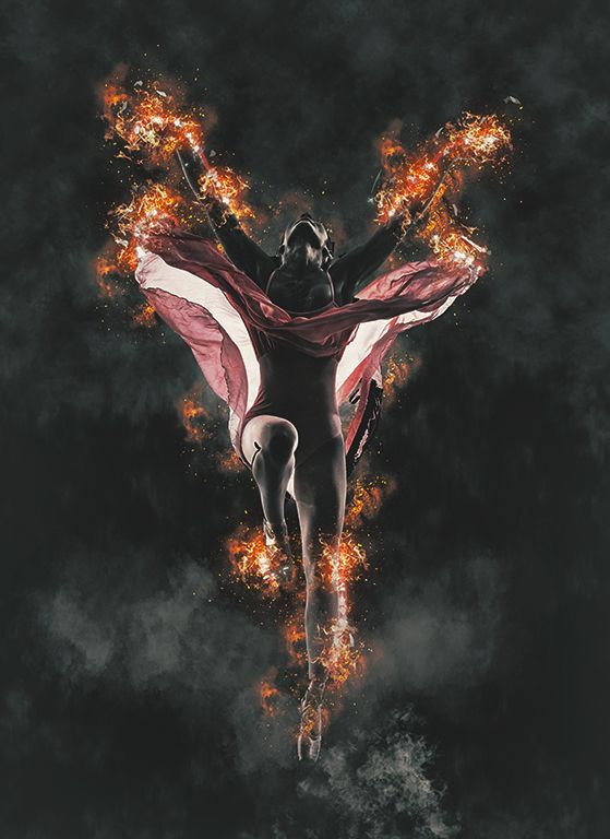 female ballet dancer with flames and smoke