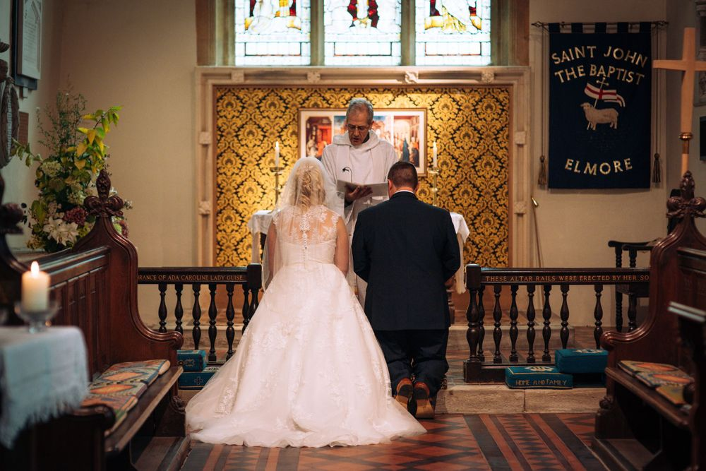 Elmore wedding by Zara Davis Photography, Gloucestershire kneeling for a blessing