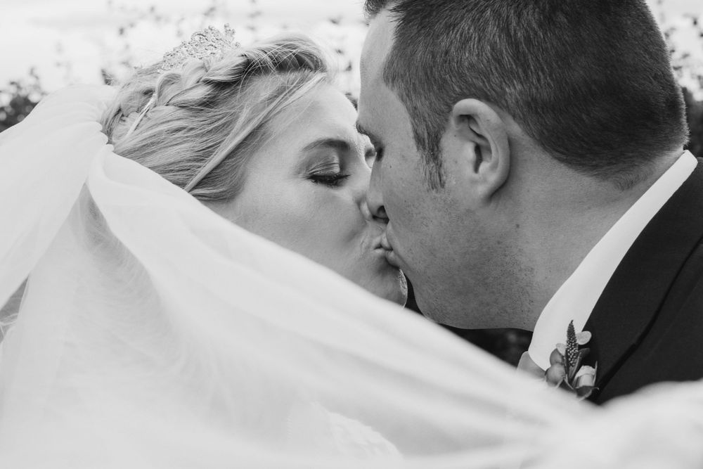 Elmore wedding by Zara Davis Photography, Gloucestershire wedding day kiss in black and white