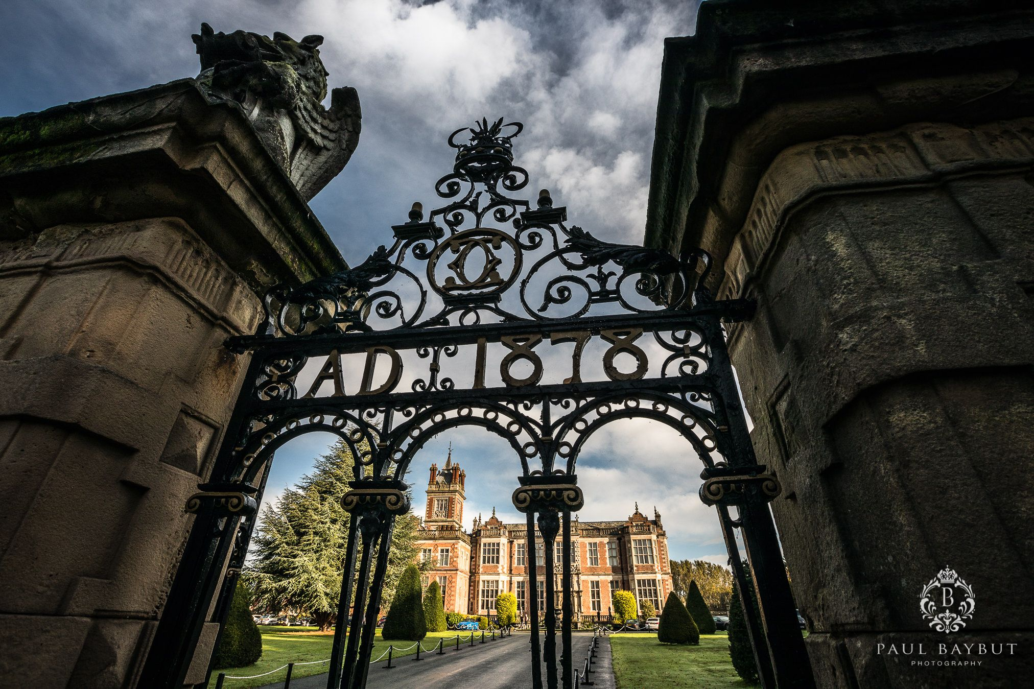 Ornate iron gates leading to a view of Crewe Hall wedding venue