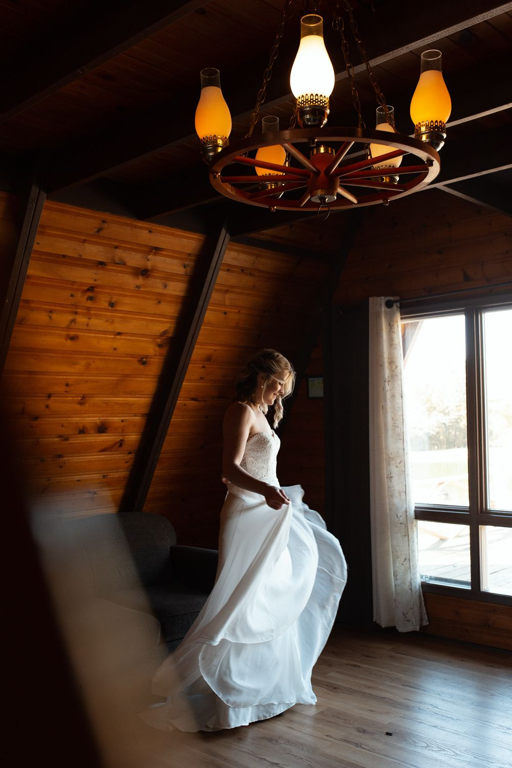 Kawartha Lakes Wedding Photographer near me Boho Wedding Bride twirling in dress
