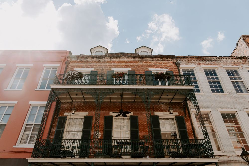Looking up view of a building in the French Quarter with a double  balcony, New Orleans Elopement Photographer