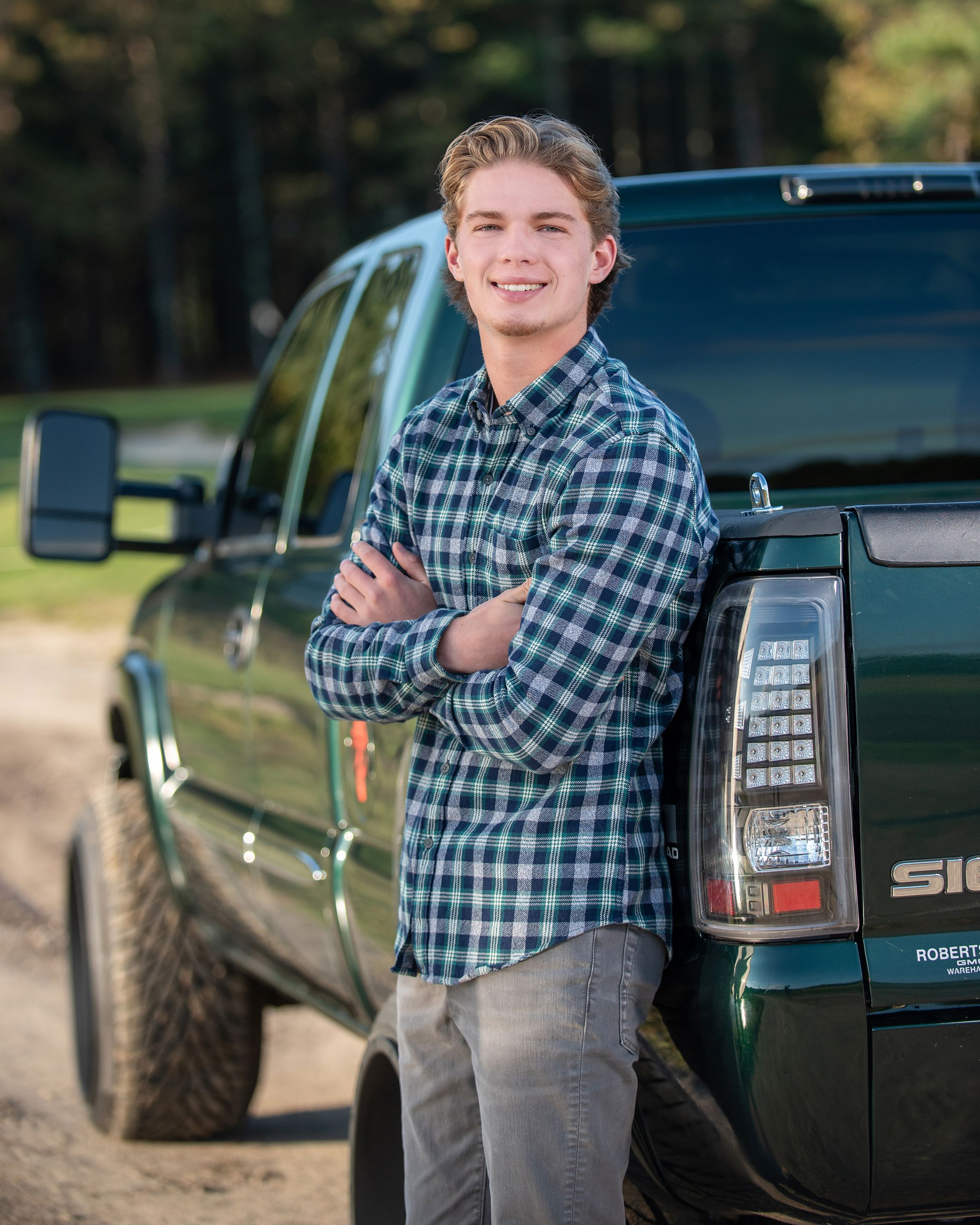 Plymouth North senior portrait of a boy with his truck by heidi harting photography