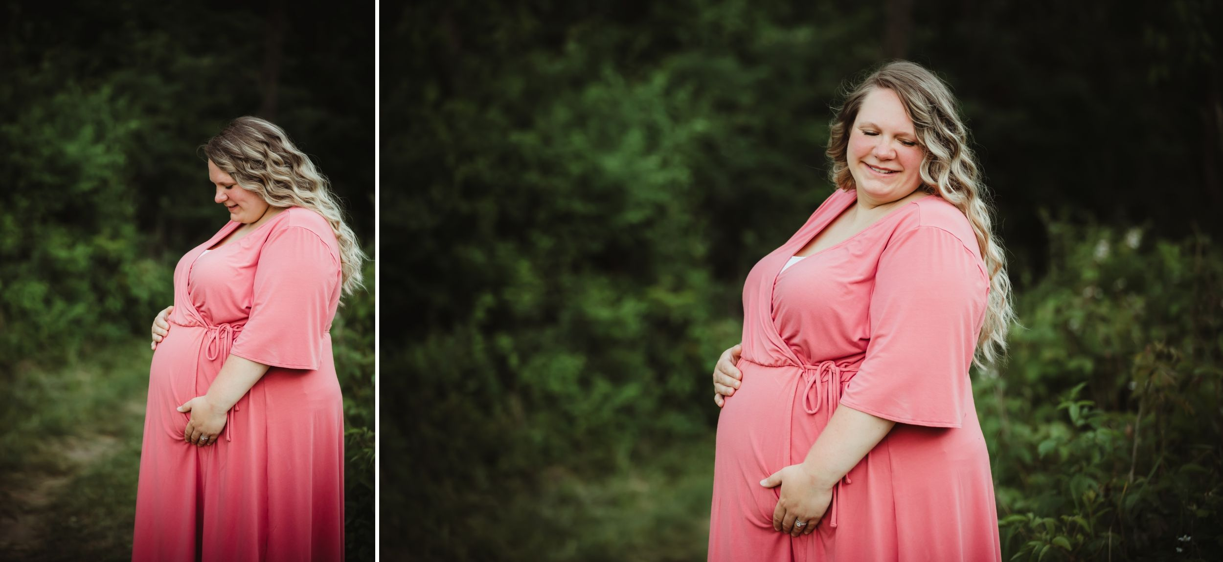 Pregnant woman in a long pink dress holding her belly and smiling with greenery around her.