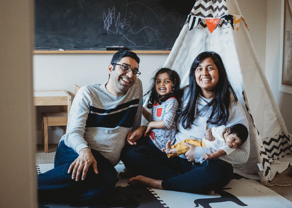 traditional family photo with newborn Seattle playroom