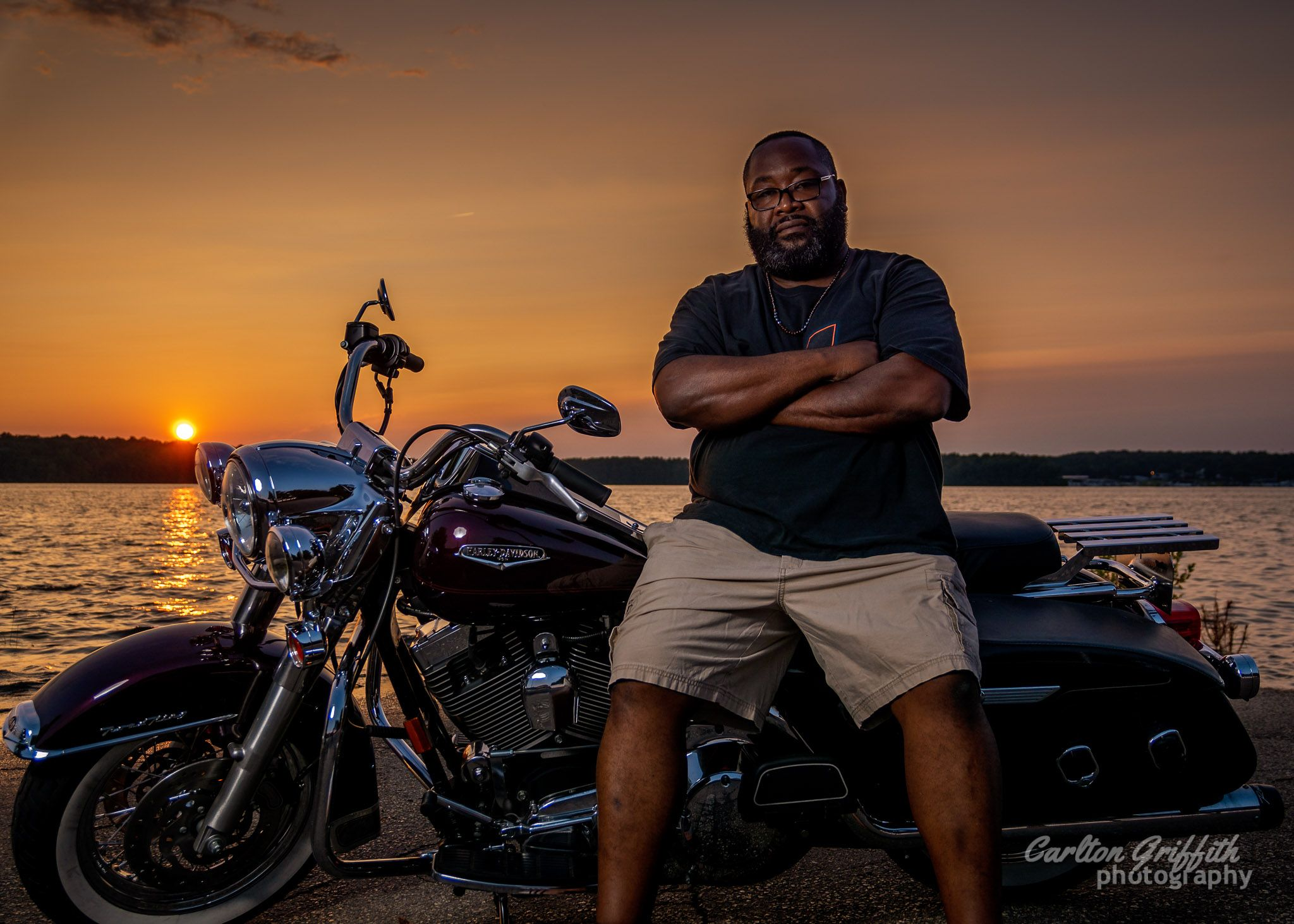 Man on motorcycle at sunset