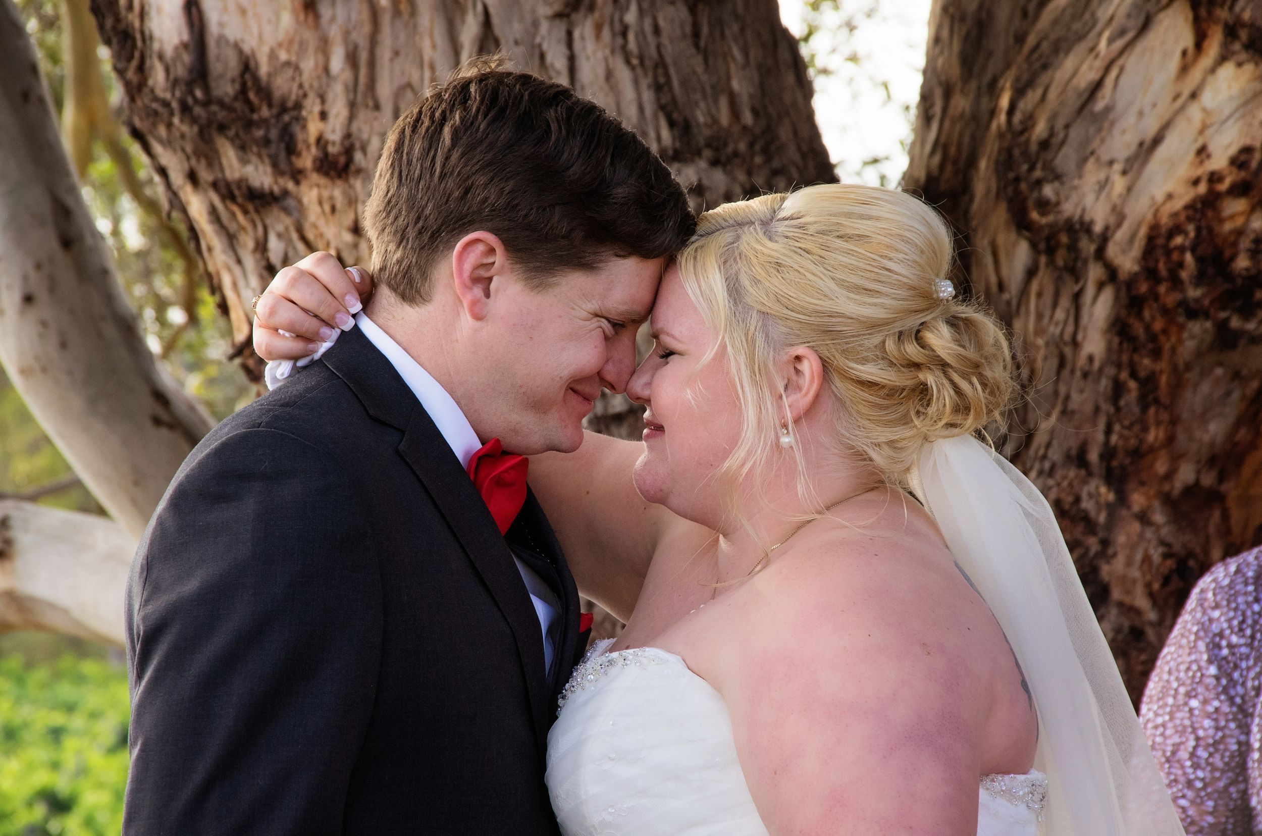 close up of bride and groom noses touching embracing close