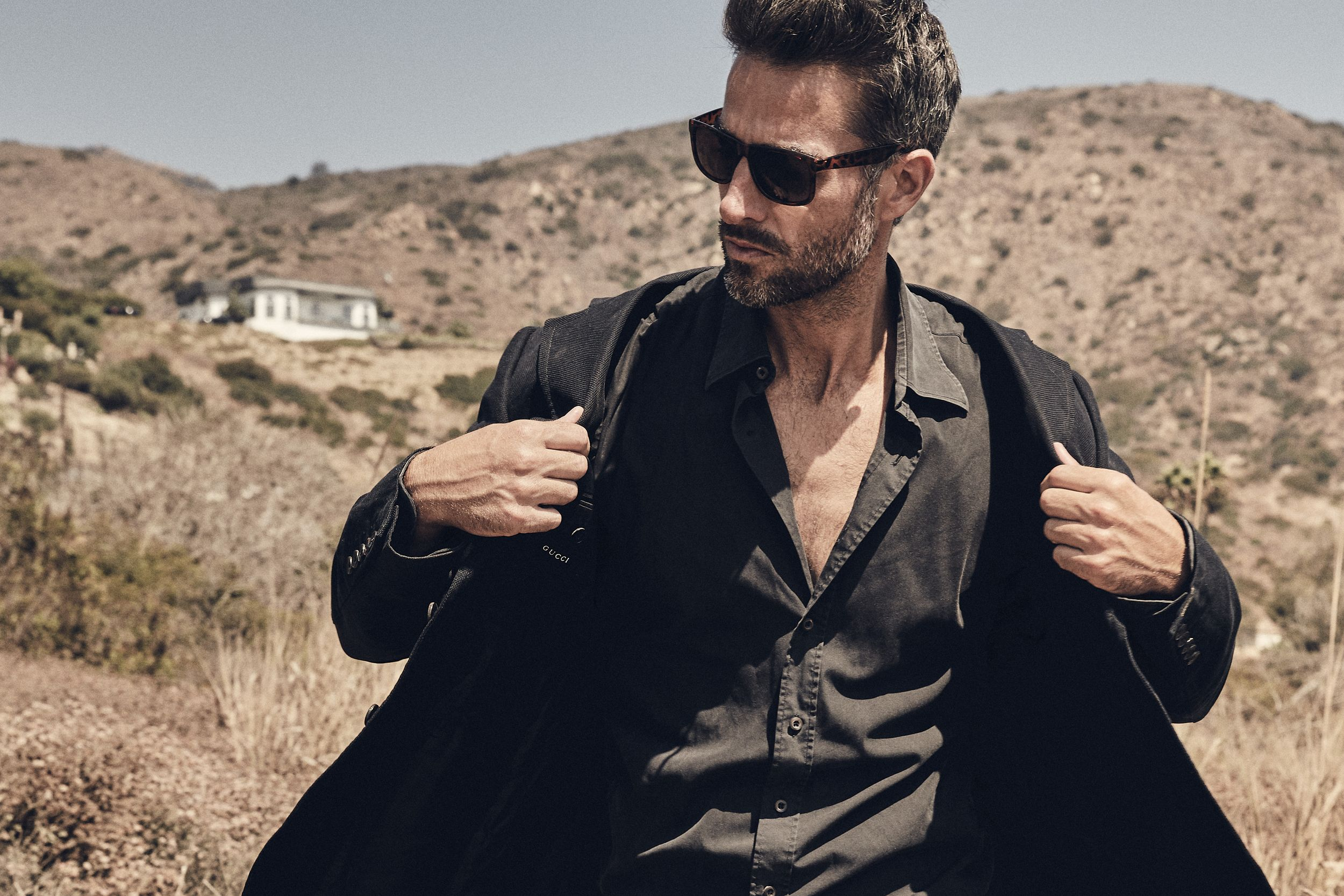 Model Colin Devitt from LA Models wearing RayBan's and Gucci suit jacket blazer at El Matador State Beach Malibu, CA