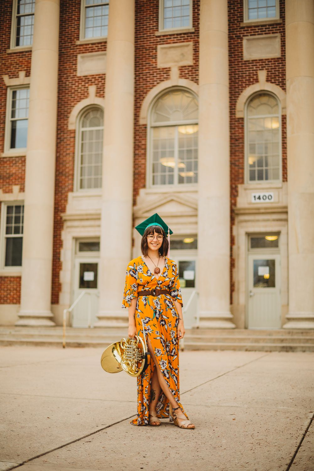 A Colorado State University graduate poses for a portrait at The University Center for the Arts in Fort Collins.