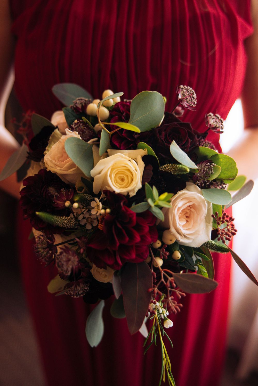 Aztec West Hotel wedding by Zara Davis Photography, Gloucestershire second bridesmaid bouquet red