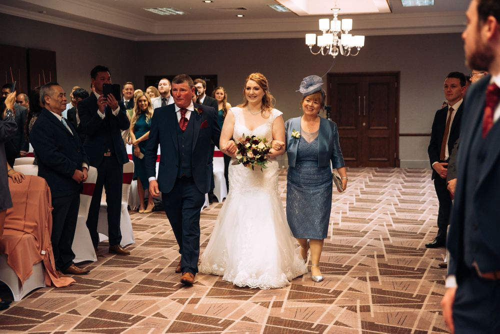 Aztec West Hotel wedding by Zara Davis Photography, Gloucestershire walking down the aisle