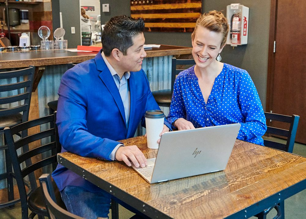 real estate agent with client in coffee shop