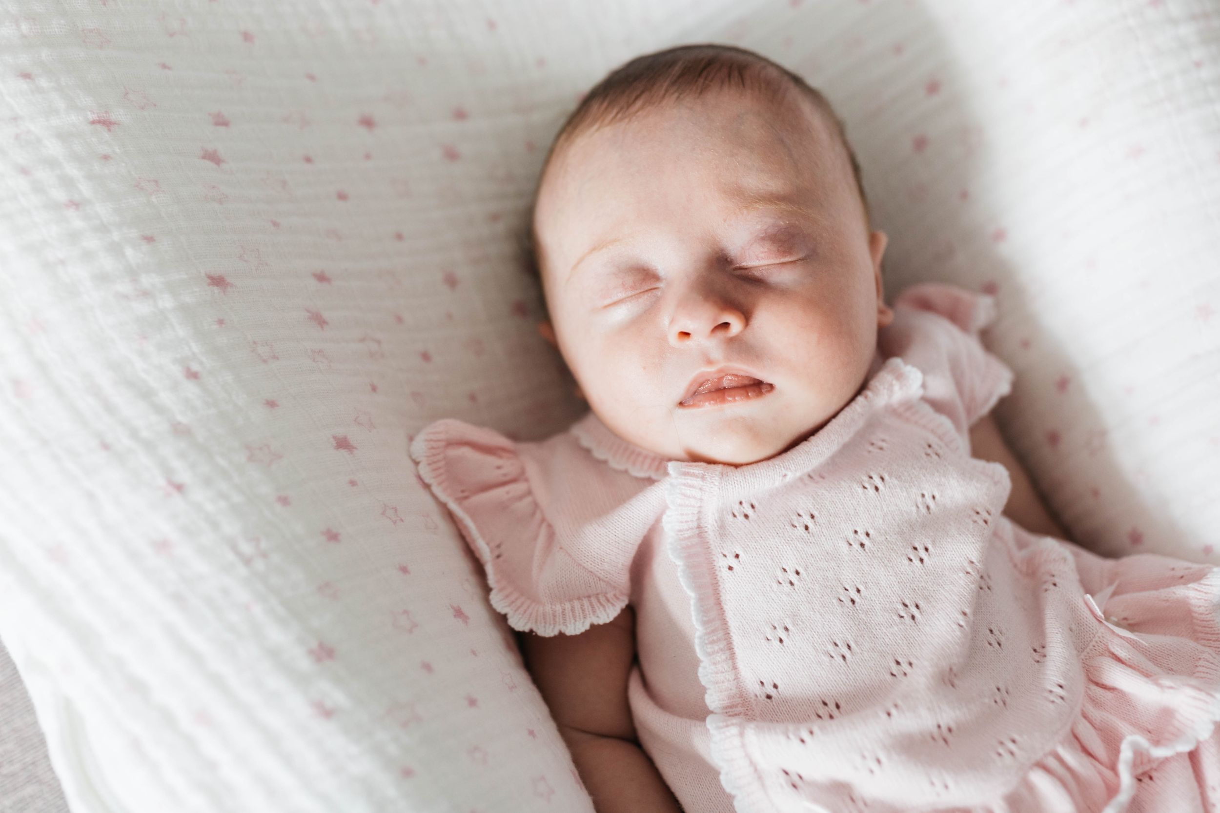the number one reason to book in-home newborn photo session sleeping baby girl