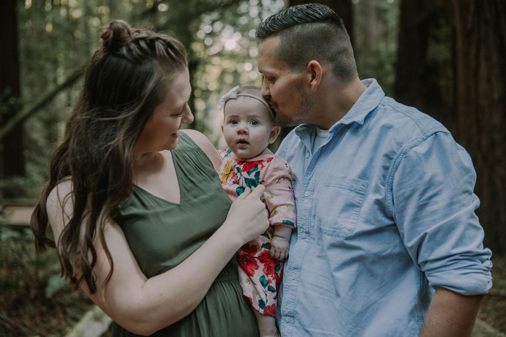 rebecca skidgel photography armstrong redwoods engagement family baby and smiling parents love kissing